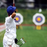 A young archer practising
