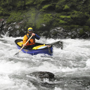 Professional canoers in some rapids