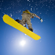 A snowboarder enjoying some air