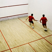 Squash players in the middle of a game