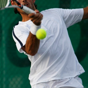 A tennis player hitting a forehand