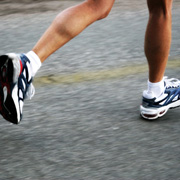The shoes of a long-distance runner