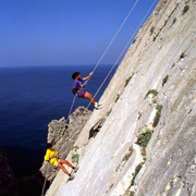 Abseiling down a sheer rock-face