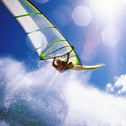 Professional windsurfer jumping a wave