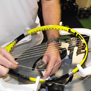 A professional racket stringer at work